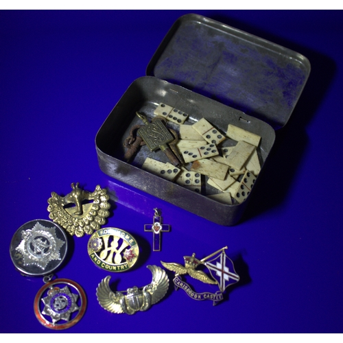 85 - Small Tin Containing A Mixed Lot Of Pin Badges, Some Enamel/Silver, Watch Keys And Miniature Bone Do...