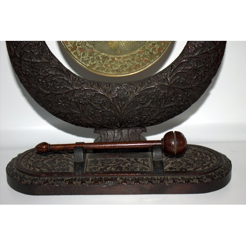 300 - Indian Carved Hardwood Table Gong, Profusely Carved Throughout, Height 12 Inches, 11 Inches Wide. La...