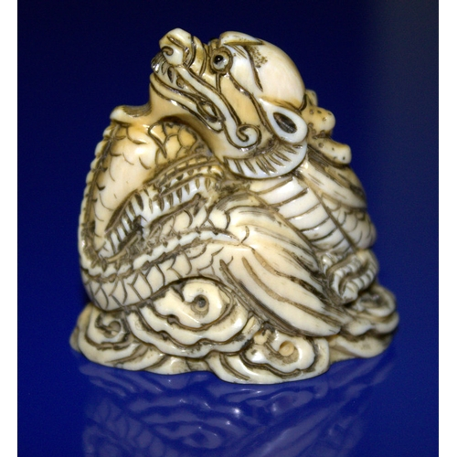 308 - Chinese Ivory Carving Depicting A Mythical Sea Serpent Amongst Waves With Horn Eyes, Signed To Base...