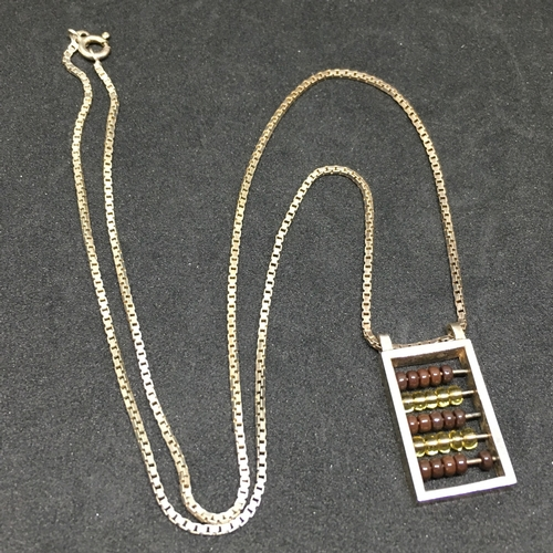 168 - Vintage Italian Silver Necklace With Abacus Pendant. Alternating rows of Red & Clear Glass Beads. Cl...