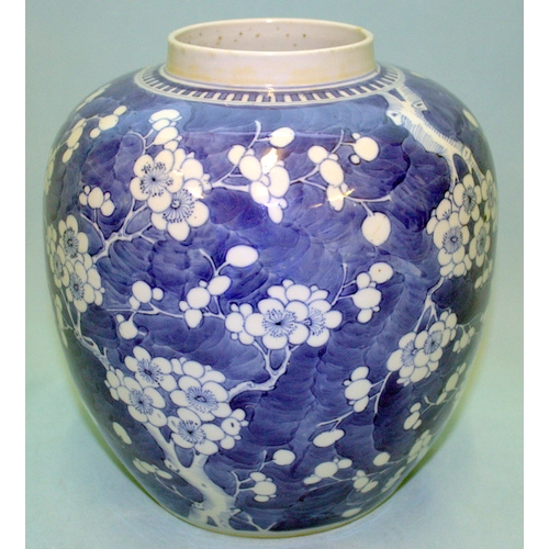 267 - A LARGE ANTIQUE CHINESE GINGER JAR decorated with flowering cherry blossom, four character marks to ...