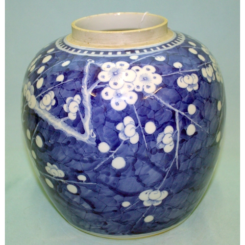 268 - A LARGE ANTIQUE CHINESE GINGER JAR decorated with flowering cherry blossoms to the body and double r...