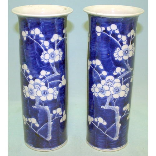 273 - A PAIR OF ANTIQUE CHINESE BLUE AND WHITE SLEEVE VASES decorated with cherry blossom, four character ...