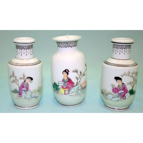 277 - A PAIR OF CHINESE FAMILE ROSE MINIATURE VASES depicting maidens reading in a garden setting, charact...