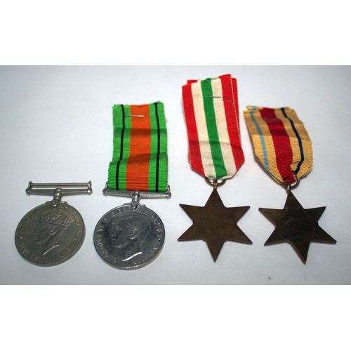 203 - Military Interest, Set Of 4 WWII Medals Comprising The Defence Medal, The 1939-1945 Medal, The Italy...