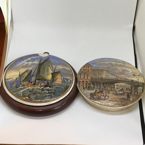455 - Two Prattware lids. Holburn Viaduct (unmounted) & Fishing Boats (Mounted). Chip to both...