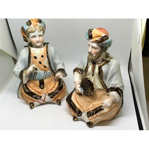 467 - 2 Circa 1900 Bisque Porcelain Bobbing / Nodding Head Figures. Father and son dressed in Middle Easte...