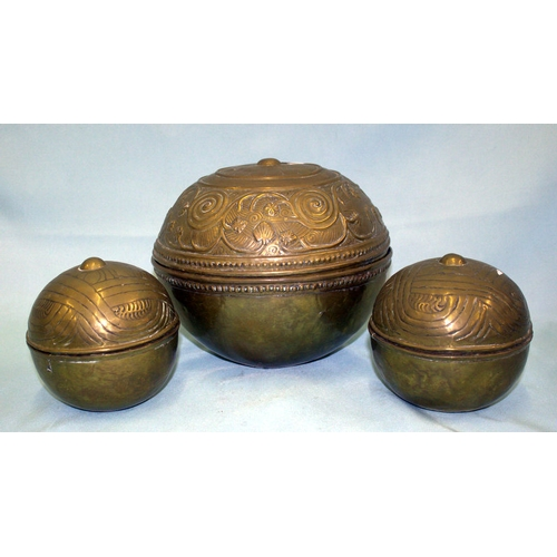 616 - A Collection Of Decorative Hammered Brass Boxes three spherical boxes in anglo indian style with emb...