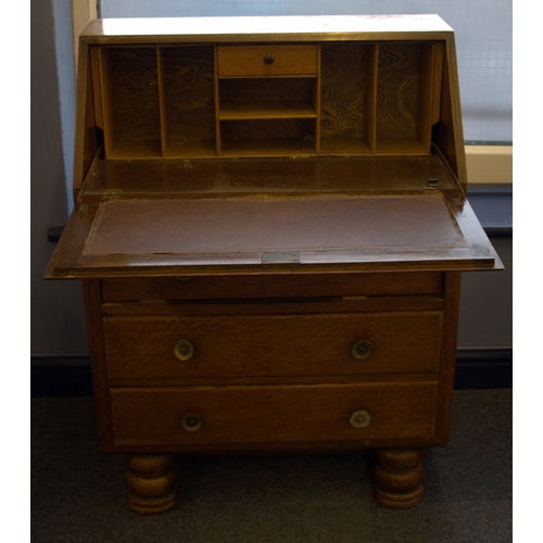 674 - Mid 20thC Oak Bureau, Fall Front With Fitted Interior Above Three Long Drawers....
