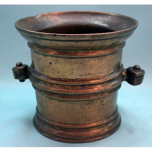 707 - 16/17thC Bronze Mortar, Ribbed body And Gripped Hand Side Handles Height 16cm...