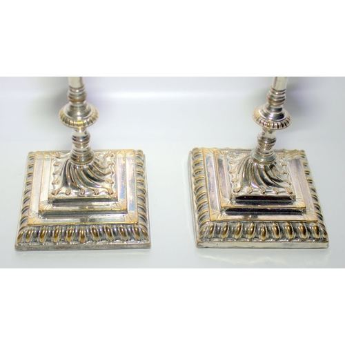 202 - Pair Of Queen Anne Style Candle Sticks, Raised On Square Stepped Bases, Height 7.5 Inches...