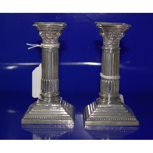 11 - Pair Of Silver Corinthian Column Candlesticks, Fluted Form On A Square Stepped Base, Fully Hallmarke...