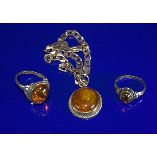 41 - A Small Collection Of Amber Stone Set Jewellery Comprising A Silver Bracelet And 2 Rings...