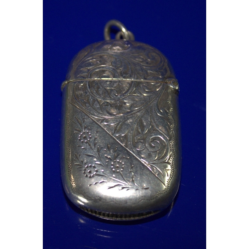 60 - Silver Vesta Case Of Oval Form With Scroll And Floral Engraving, Fully Hallmarked With Striker To Ba...