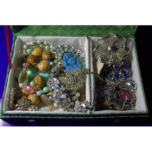 64 - Box Containing A Mixed Lot Of Costume Jewellery To Include Brooches, Beads, Necklaces, Pendants Etc....