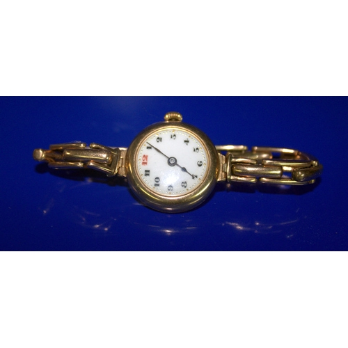 66 - Ladies 9ct Gold Wristwatch, White Enamelled Dial, arabic Numerals, Manual Wind. Early 20thC...