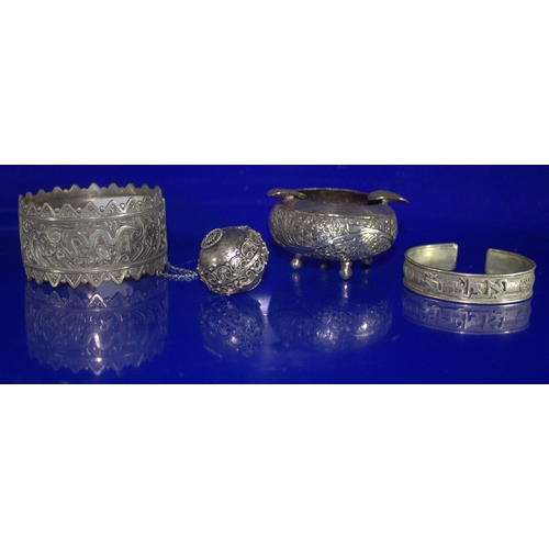 414 - Four Pieces Of Middle Eastern White Metal, Two Bangles, Ashtray And A Pommel...