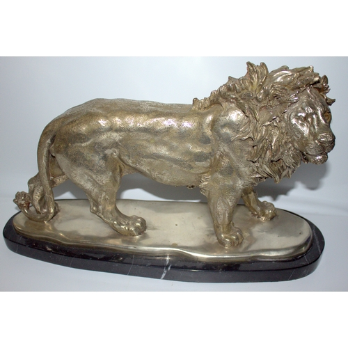 529 - Large 20thC Silvered Bronze Sculpture Depicting A Majestic Standing Lion, Mounted On A Black Marble ...
