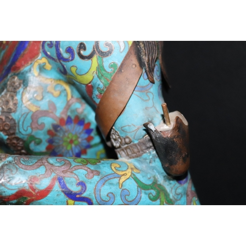 220 - A LARGE 19th CENTURY CHINESE CLOISONNE BUDDHA seated on plinth base with candle holders to each arm ...