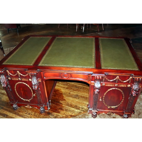 727 - A 20thC Mahogany Library Desk; After A Design By Thomas Chippendale. The Green Leather Writing Surfa...