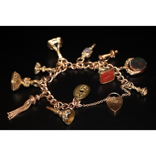 3 - 9ct Gold Charm Bracelet With 11 Charms And 1 Heart Padlock, Bracelet Stamped 375, 52.4 Grams Total W...