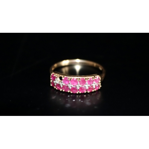 65 - 9ct Gold Ladies Dress Ring Set With Two Rows of Pink Gem Stones Across A Row of White Gem Stones, St...
