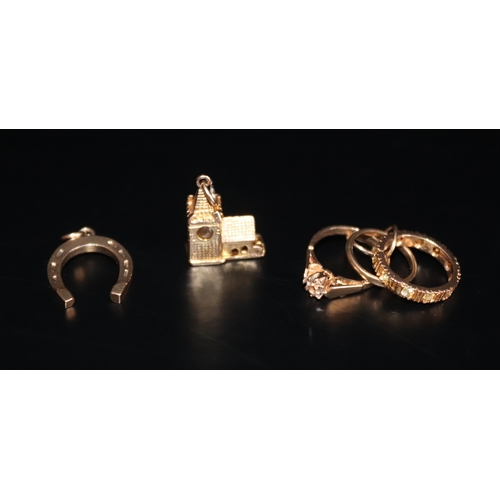 51 - Three 9ct Gold Charms Comprising Ring Set, Lucky Horseshoe And Hinged Church, Weight Approx 7.5g...