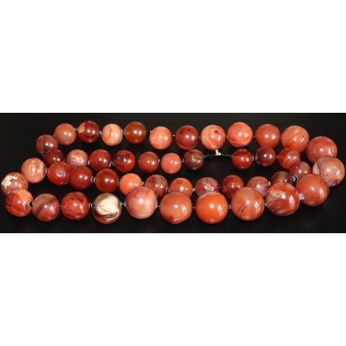 83 - A Large Graduating strand of Hardstone Beads, Length  40 inches, Largest Bead 25mm, Weight 580g...