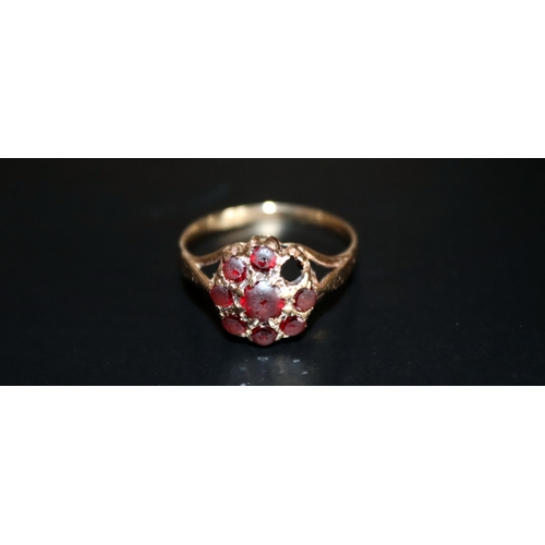 129 - 9ct Gold Cluster Ring Set With Red Stones (One Missing), Stamped 9ct Gold, Ring Size P 1/2, Weight A...