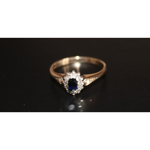 146 - 9ct Gold Ladies Dress Ring Set With Dark Sapphire And Diamond Chips, Ring Size M, Weight 2g...