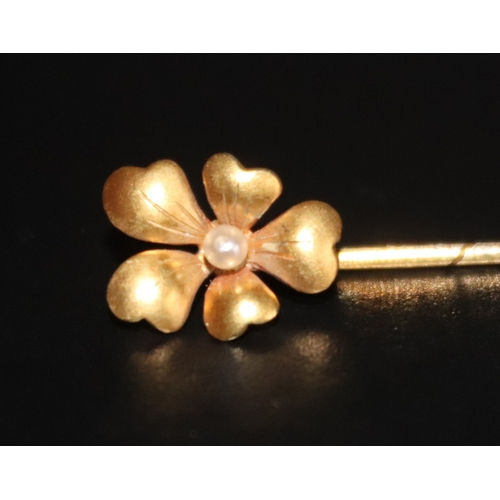 24 - 15ct gold Stick Pin Formed As A Brushed Gold Flowerhead With Central Seed pearl, Stamped With A 15 T...