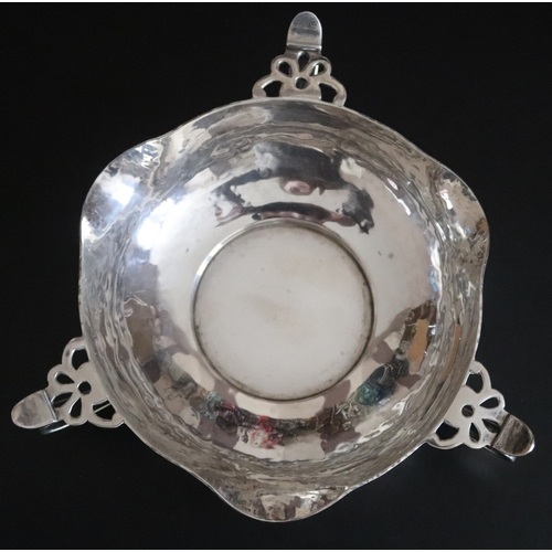 36 - Arts And Crafts Silver Footed Bowl Planished form with three pierced handles. Fully hallmarked Londo...