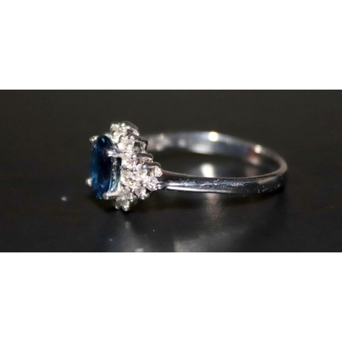 229 - 18ct White Gold Sapphire And Diamond Cluster Ring Complete With Thai Certificate Of Guarantee. Sapph...