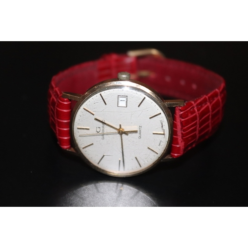 164 - Gents 9ct Gold Garrard Wristwatch, Champagne Dial, Baton Numerals,Center Seconds With Date Aperture....