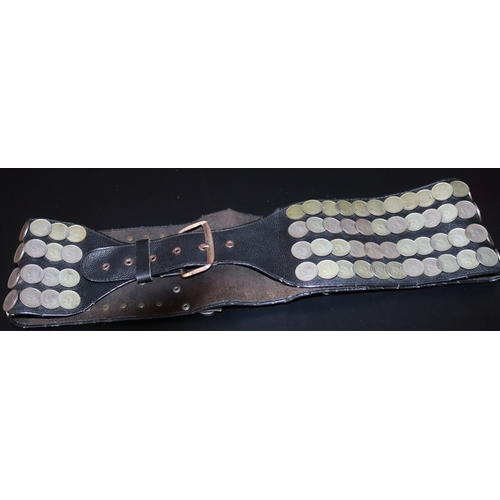 281 - Argentinian black leather belt decorated with 106 coins and shield like buckle...