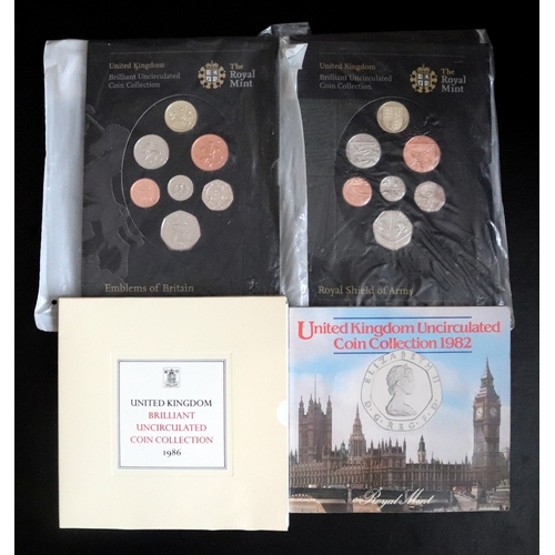 468 - 4 Royal Mint Uncirculated Coin Collections Comprising 1982, 1986, Royal Shield Of Arms And Emblems O...