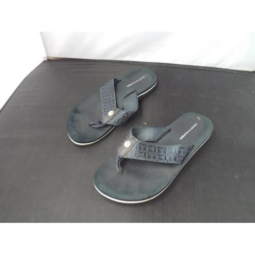 27 - Lady's Tommy Hilfiger flip flops...
