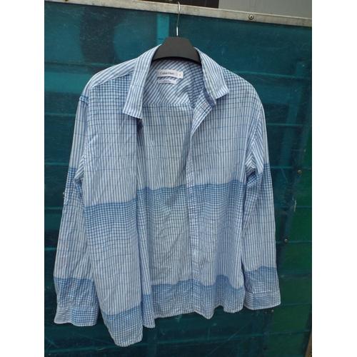 59 - Calvin Klein shirt size M...