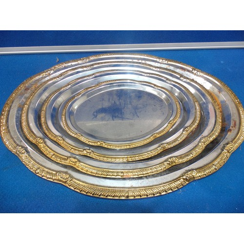 46 - 4 stainless steel serving trays...
