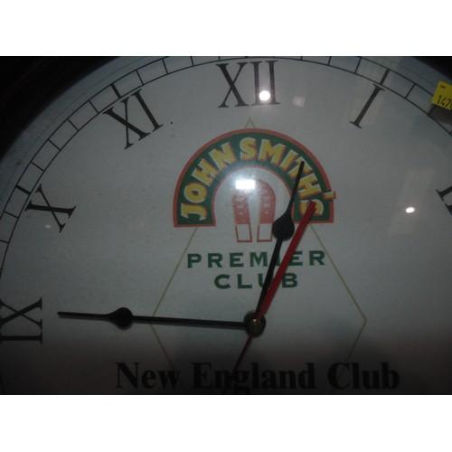 59 - John Smiths premier club clock...
