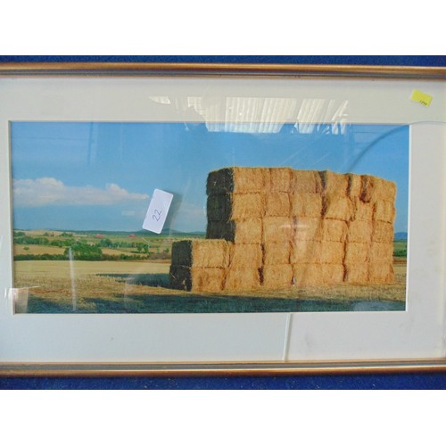 69 - Framed photograph of landscape and hay stacks....