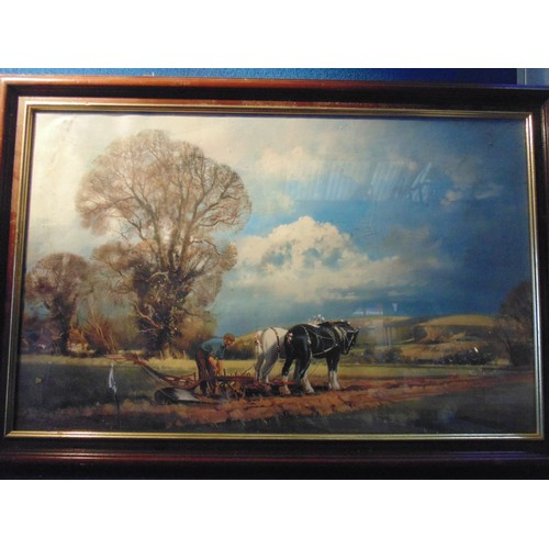 105 - Framed print of countryside scene depicting two horses and farmer ploughing....
