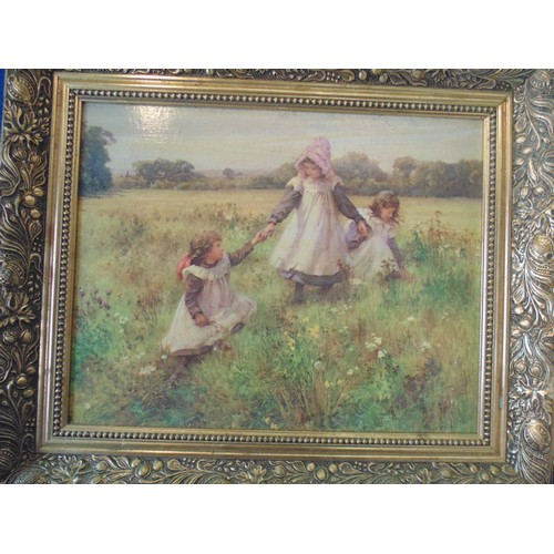 130 - Framed print of children playing in fields....