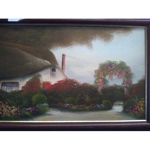 149 - Framed oil painting on board of cottage....