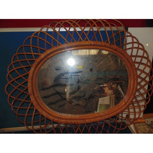 491 - Wicker oval mirror...