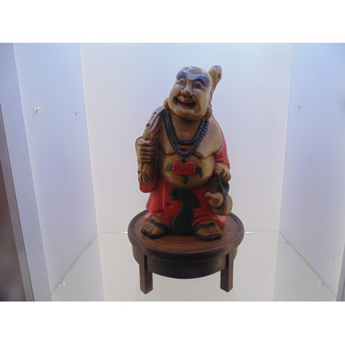 992 - Wooden carved Buddha on wooden stand (20