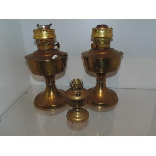 1070 - 2 brass oil lamps...