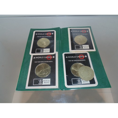 1073 - World savers royal mint medals...