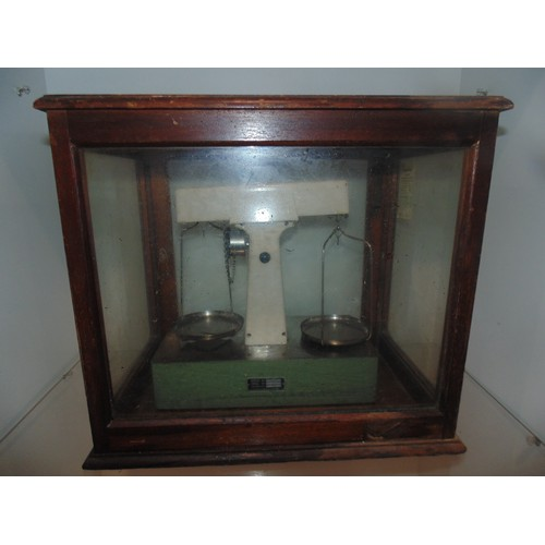 1077 - Antique weighing scales in glass display box...