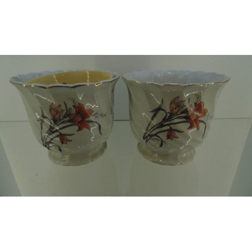 128 - Pair of white vase with floral pattern and gold coloured rim...
